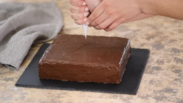 Thumbnail for Decorate the Cake with Chocolate. Preparation of Desserts in the Kitchen, Production of