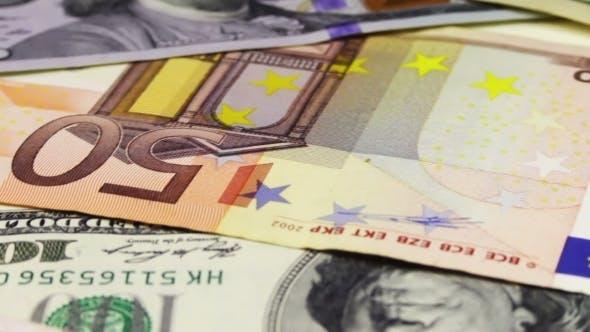 Thumbnail for Dollars And Euro Banknotes Rotate