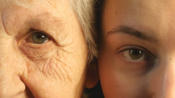 Thumbnail for Grandmother And Granddaughter Looking Together At Camera