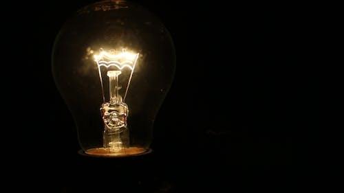 A Light Bulb Illuminates in a Dark Room