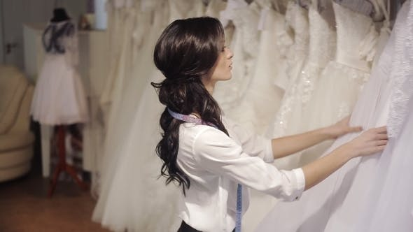 Thumbnail for Salon Manager Wedding Fashion Chooses a White Dress For The Bride