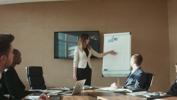Thumbnail for Colleagues Applauding Businesswoman In Office