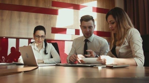 Thumbnail for Businessmen Discussing Diagrams Using Laptop