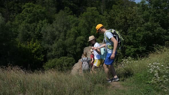 Thumbnail for Group of Hikers Stepping Down Along Rocky Path