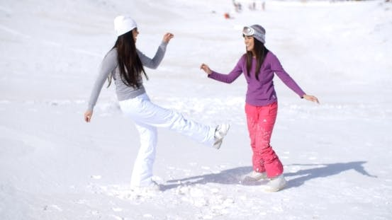Thumbnail for Two Young Woman Frolicking In Winter Snow