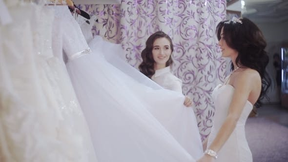 Thumbnail for Bride In Wedding Salon Chooses a Wedding Dress