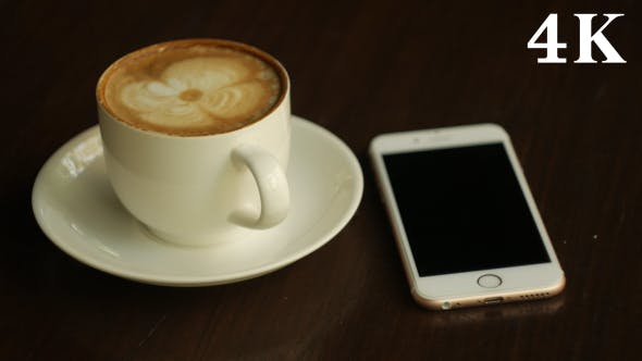 Thumbnail for Using Smartphone and Drinking Coffee
