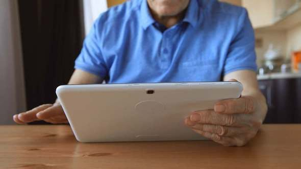 Thumbnail for Aged Male hands with a tablet PC at home