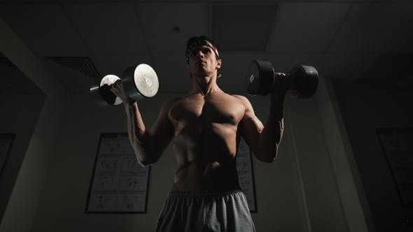 Cover Image for Fit Athlete Working Out Biceps - Dumbbell Concentration Curls