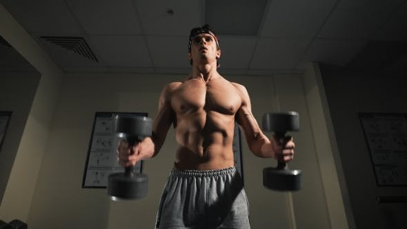 Thumbnail for Strong Man, Bodybuilder Exercising With Dumbbells In a Gym