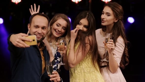 Thumbnail for Group Of Friends At a Party Drinking Champagne Do Selfies Smartphone