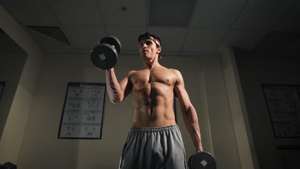 Thumbnail for The Man With Dumbbells In Sports Club