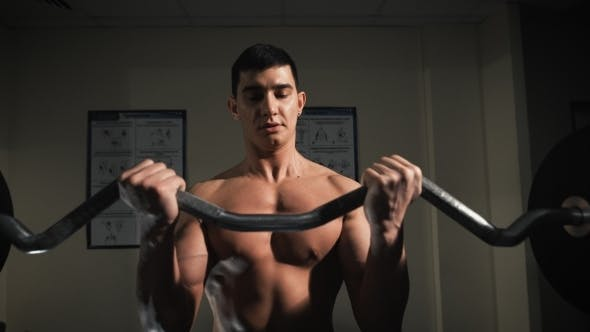 Thumbnail for Muscular Man Doing Heavy Weight Exercise For Biceps