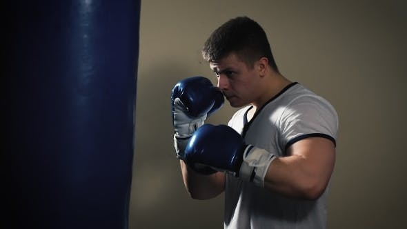 Thumbnail for Male Boxer At The Gym Hitting The Punching Ball