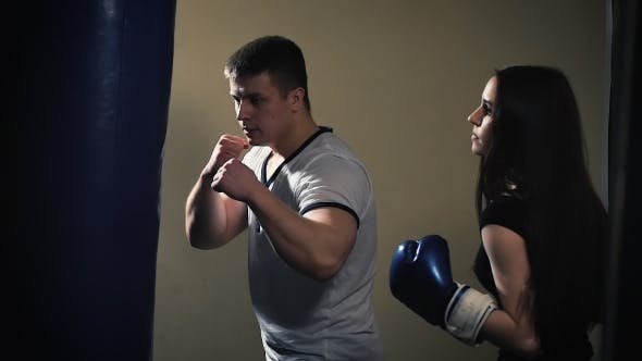Thumbnail for Cute Brunette Woman Training With Boxing Gloves At The Gym