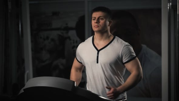 Thumbnail for Man On Running Machine In Gym