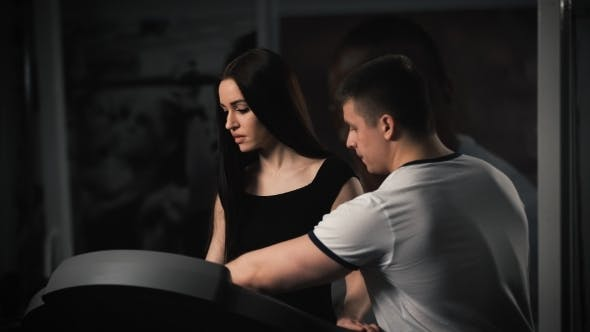 Thumbnail for Attractive Young Woman Doing Cardio Exercise On Treadmill At Gym