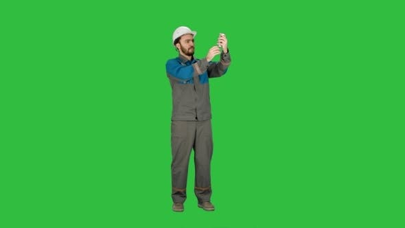 Thumbnail for Construction Engineer Makes Selfie On The Phone. Green Screen, Chroma Key.