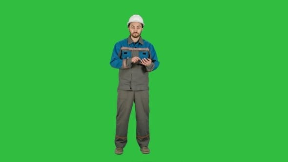 Thumbnail for Engineer Builder Using Tablet And Walkie Talkie, Giving Instructions At a Construction Site On a