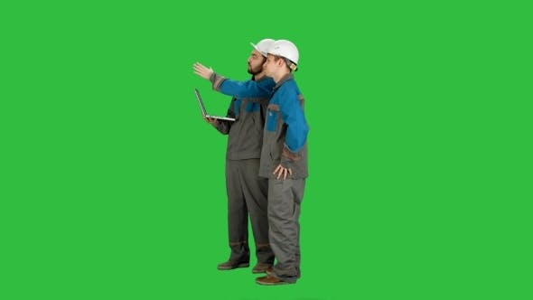 Thumbnail for Supervisors Using Laptop At Construction Site On a Green Screen, Chroma Key.
