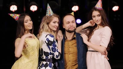 Male Birthday With Their Girlfriends Posing At a Birthday Party
