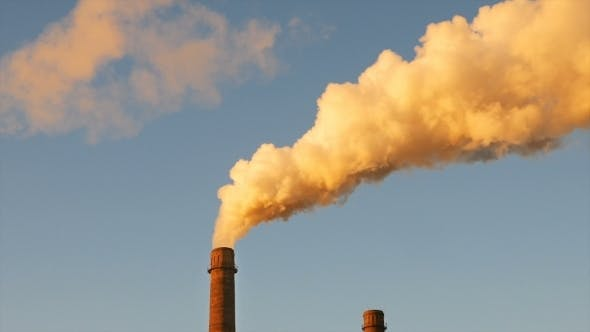 Thumbnail for Factory Plant Smoke Stack Over Blue Sky Background