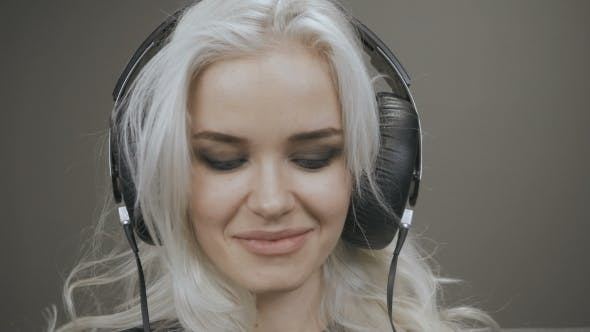 Thumbnail for Beautiful Blonde Model Girl Listening Music With Headphones And Smile