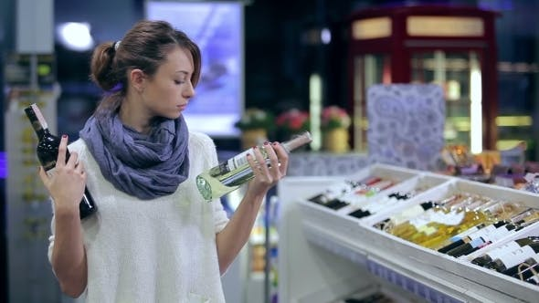 Thumbnail for Attractive Girl Cant Make Choise In Buying Wine