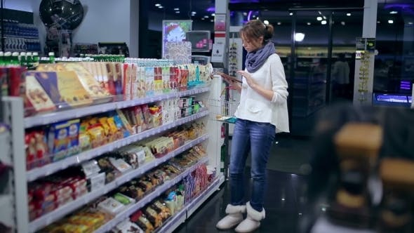 Thumbnail for Girl Browses Shopping List On The Tablet