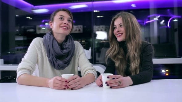 Thumbnail for Girls Talking In Cafe