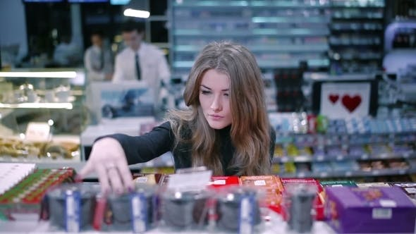 Thumbnail for Beautiful Girl Selects Products In Supermarket