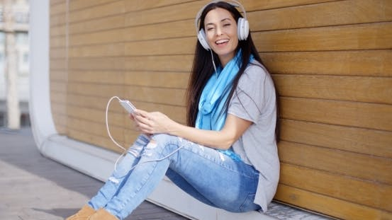 Thumbnail for Pretty Trendy Young Woman Enjoying Her Music