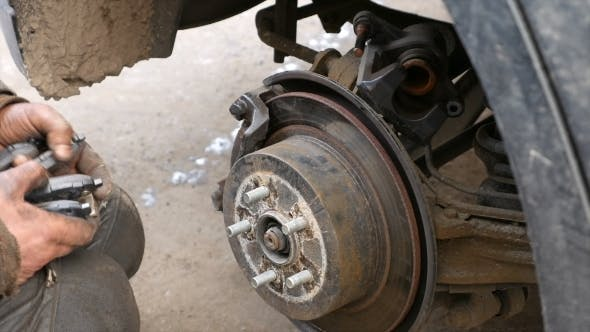Thumbnail for Auto Mechanic Working On Brakes In Car Repair Shop