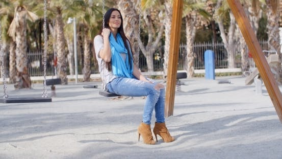 Thumbnail for Stylish Young Woman On a Swing