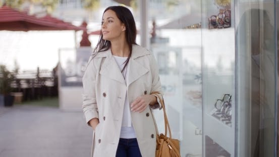 Thumbnail for Smiling Stylish Woman Walking Past a Shop