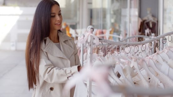 Thumbnail for Attractive Young Woman Shopping For Clothing