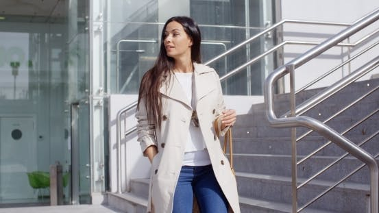 Thumbnail for Stylish Woman Walking Down a Flight Of Stairs