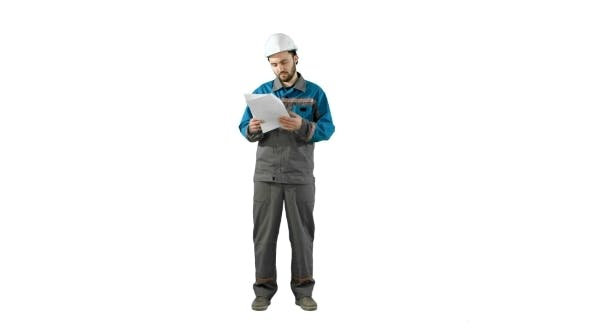 Thumbnail for Engineer Man Verify And Read Files Documents On White Background.