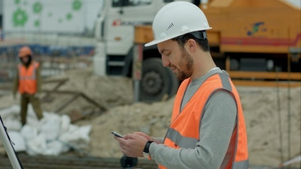 Thumbnail for Construction Worker Using Cell Phone