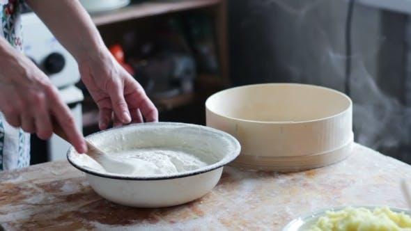 Thumbnail for Prepares The Dough On Domestic Kitchen