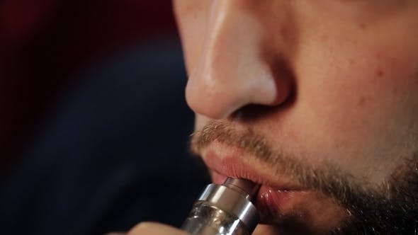 Thumbnail for Man Exhaling Smoke From a Vaporizer