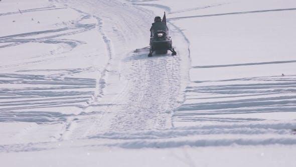 Thumbnail for Snowmobile Riding On Sidewalk