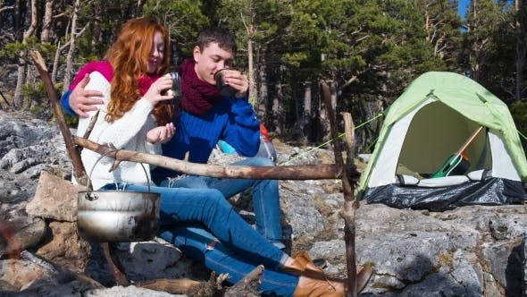 Thumbnail for Couple Of Tourists Relaxing Outdoors With Backpacks And Camp