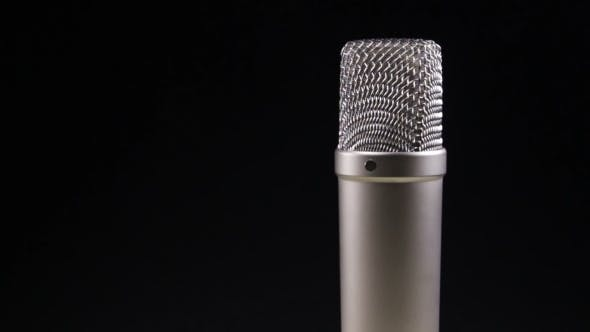 Thumbnail for Studio Microphone Rotates On a Black Background