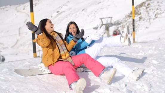 Thumbnail for Two Happy Young Women Enjoying a Winter Holiday