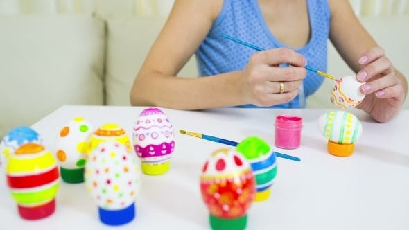 Thumbnail for Woman Painting Easter Egg At Home