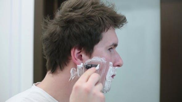 Thumbnail for Brunette Man In White T-shirt Shaves
