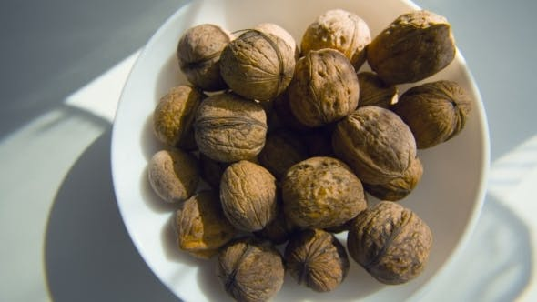 Thumbnail for Walnut In a Plate On The White Background