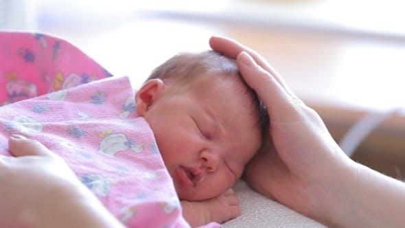 Mom Puts To Sleep Newborn Baby