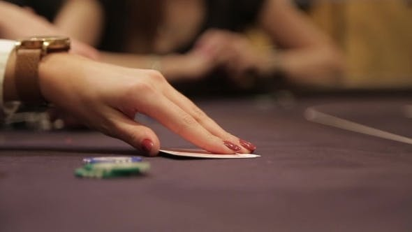 Thumbnail for Woman Looking Cards In Poker